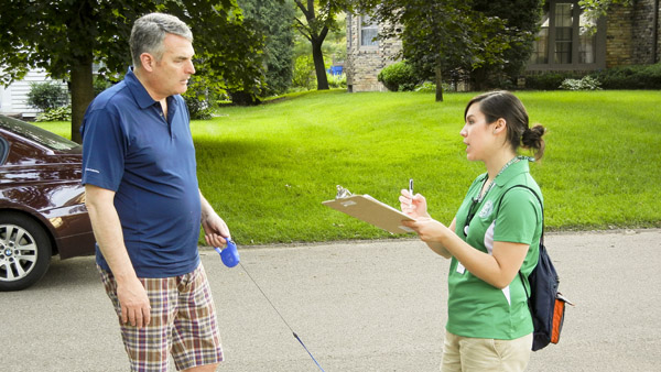 Team member collecting input from neighborhood stakeholders through an intercept survey.