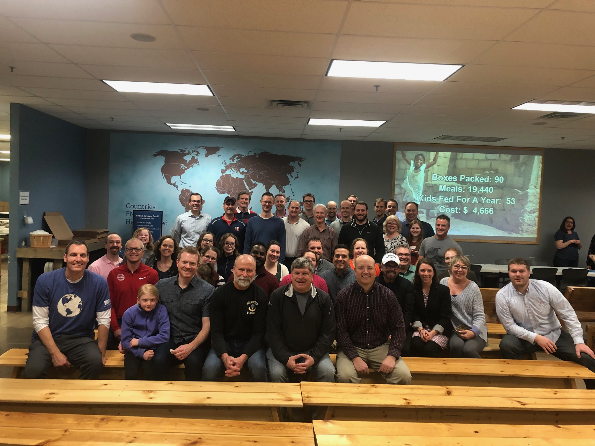 Members Pack Food at Feed My Starving Children